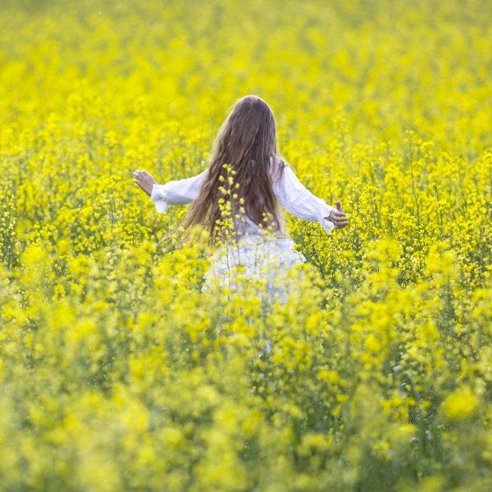 Girl in rapeseed field